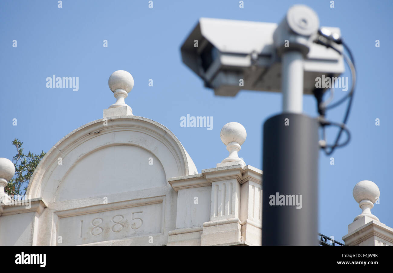 surveillance camera by old building 1885 Stock Photo