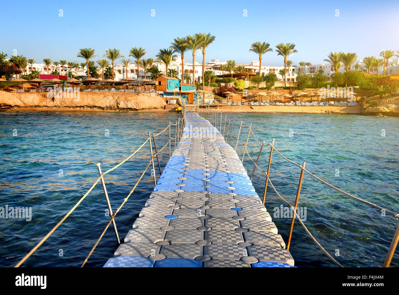 Pontoon through coral reef to the sea - Stock Image