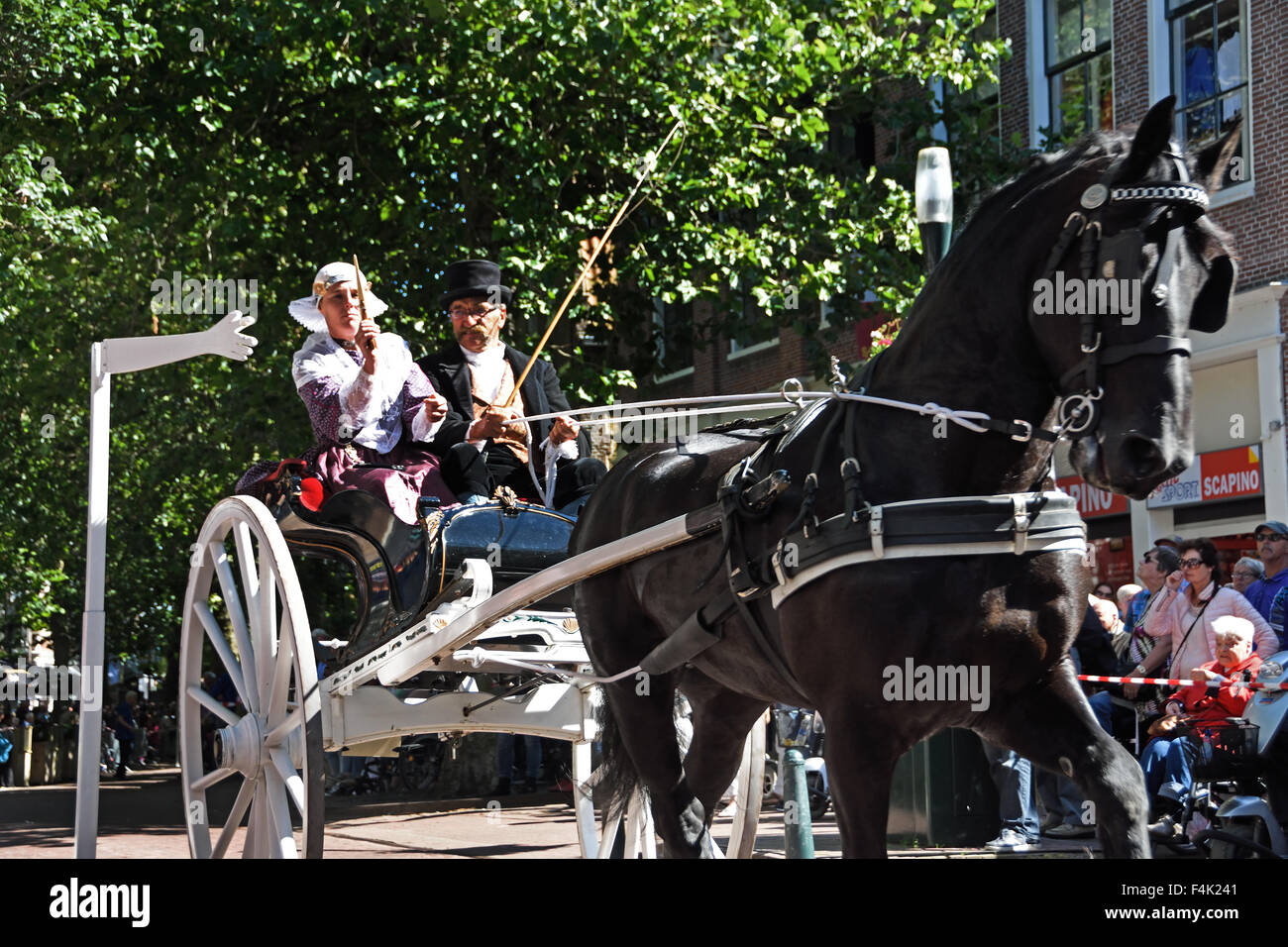 Harlingen Friesland Stabbing ring or ring drive is a folk tradition horse cart ( lance through a ring trying to - Stock Image