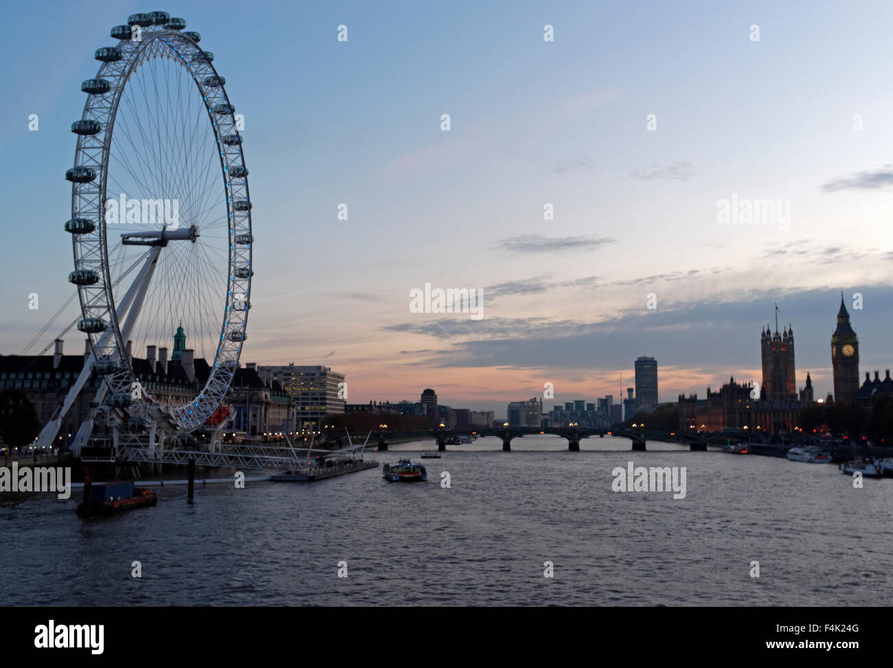 London Eye overlooking River Thames at dusk, London England - Stock Image
