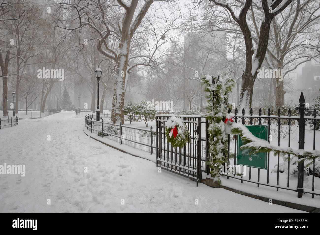 Madison Square Park covered with snow. Wintertime in the Flatiron District, Midtown Manhattan, New York City, USA - Stock Image