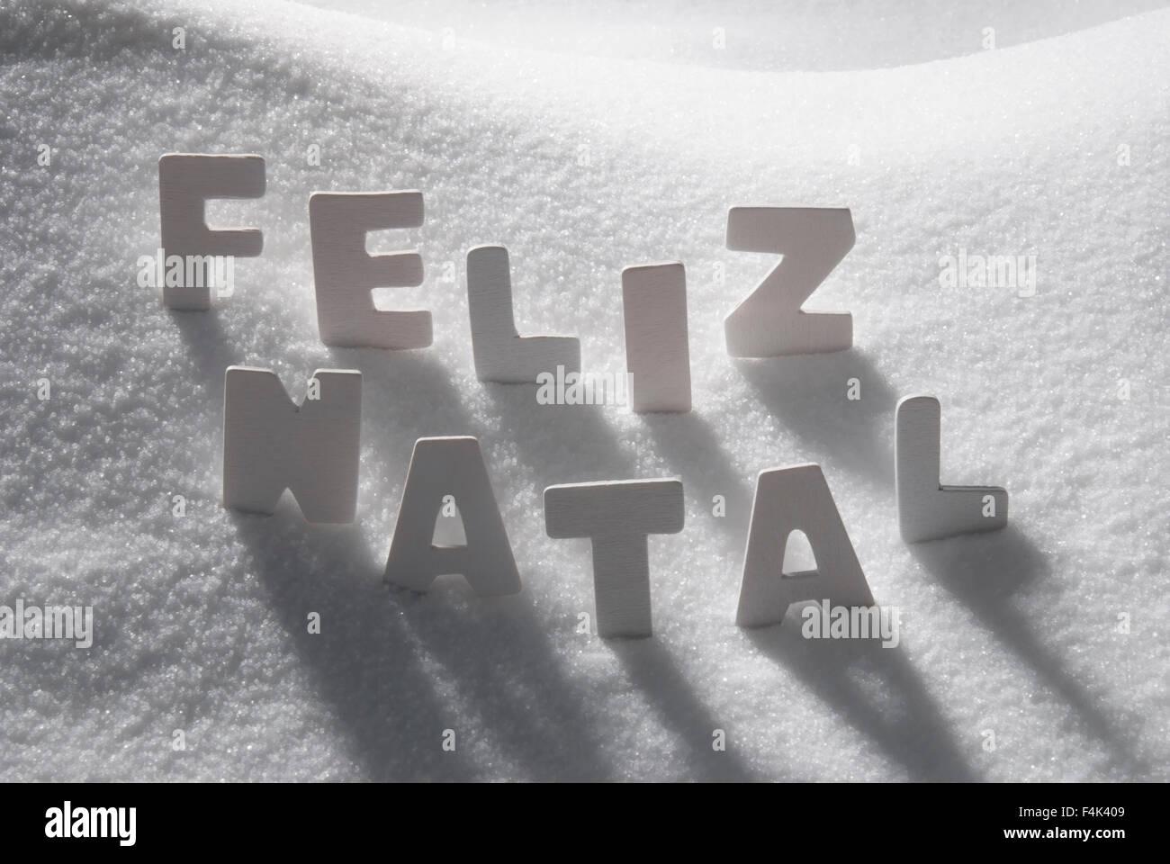 White Word Feliz Natal Mean Merry Christmas On Snow Stock Photo ...