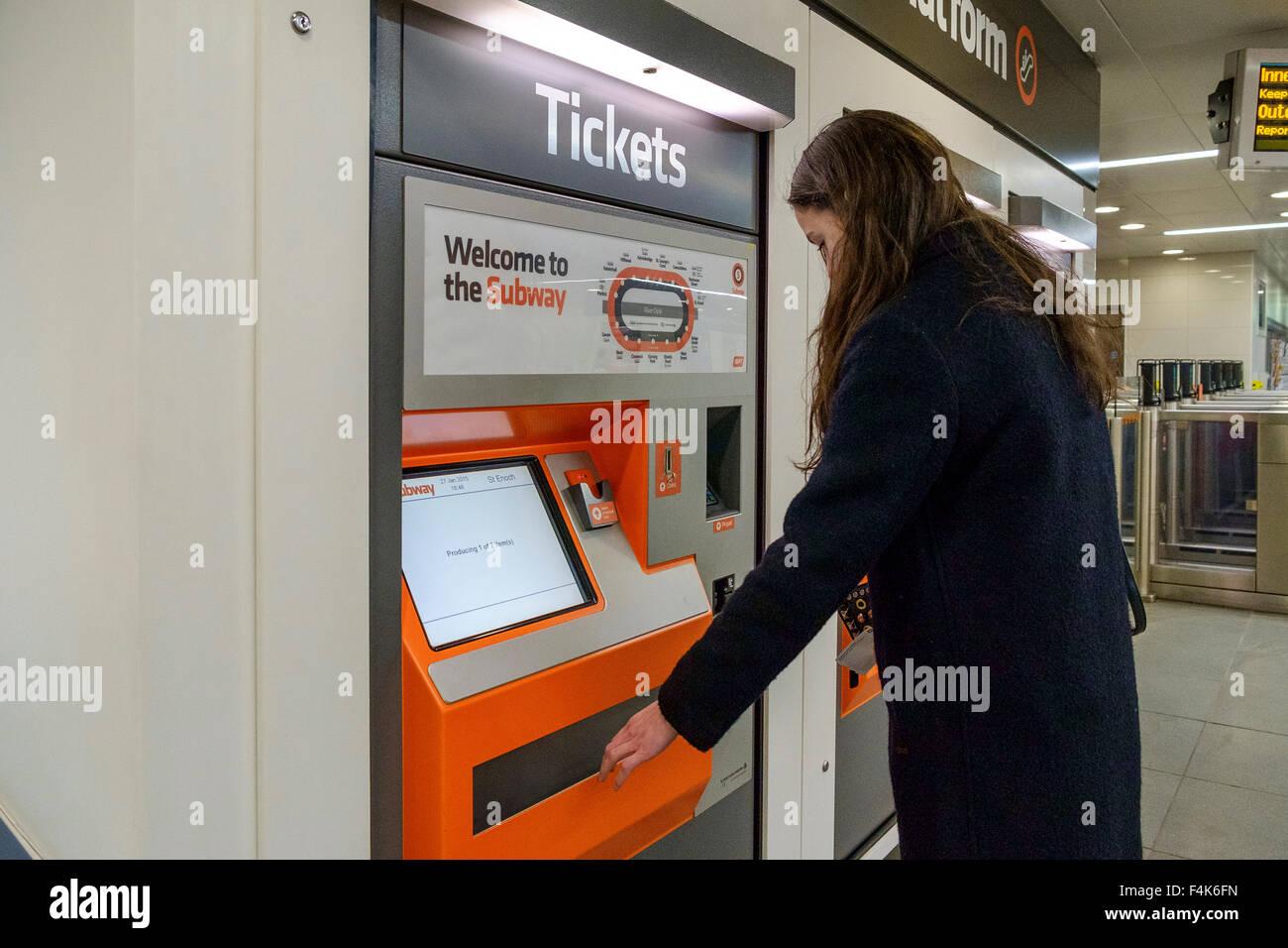 woman girl glasgow subway ticket machine - Stock Image