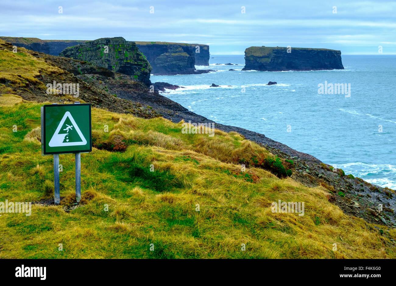 warning sign danger rocks waves no swimming coast - Stock Image