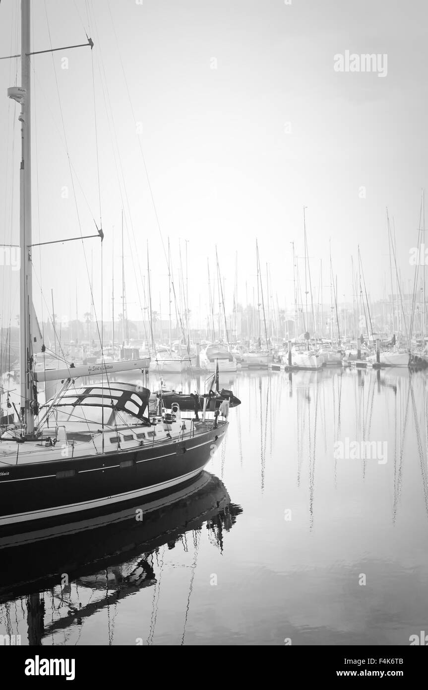 Marina de Lagos, Lagos, Algarve, Portugal, 2015-10-16. Boats moored during a dense fog in the marina. - Stock Image
