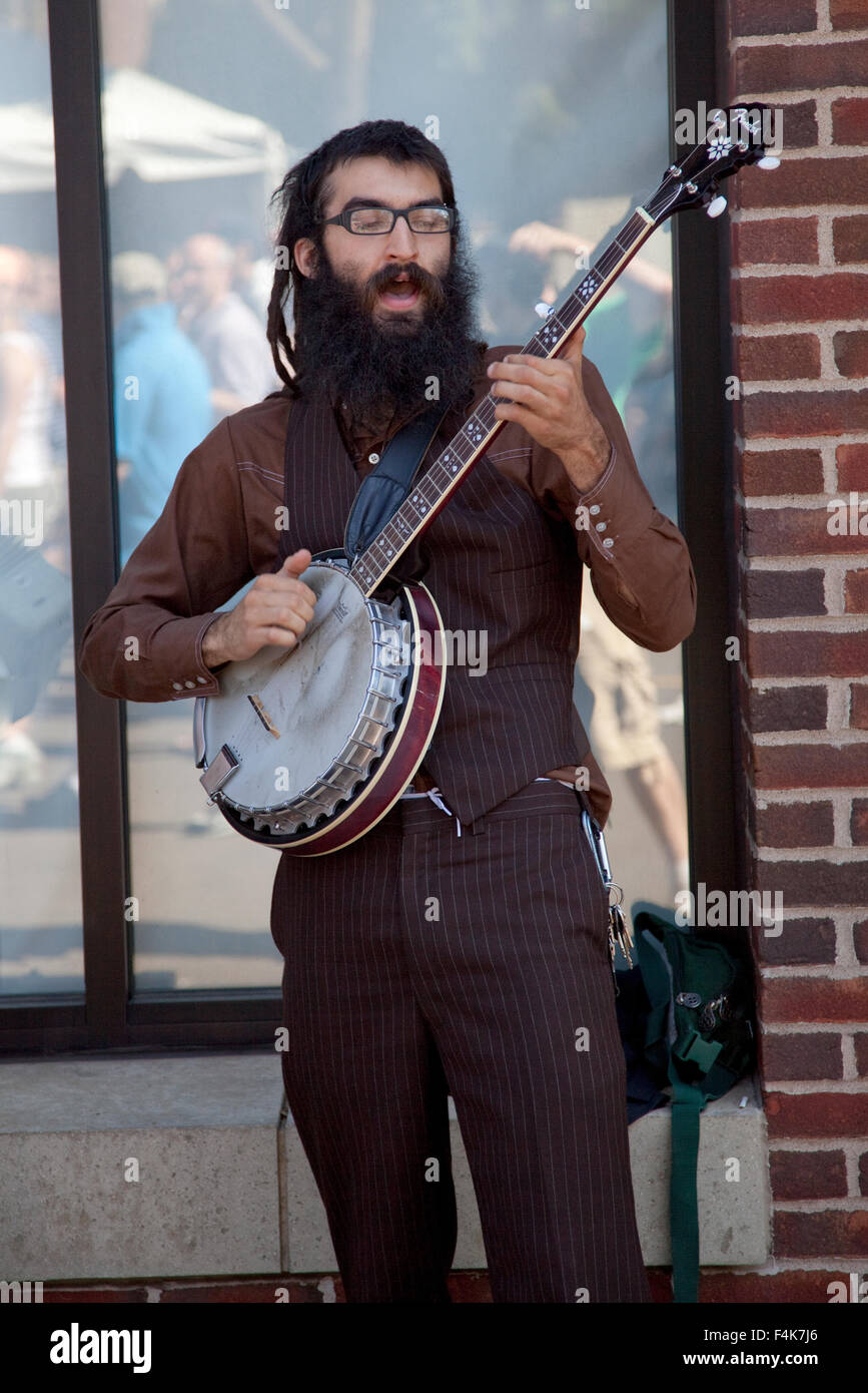 Bearded man playing banjo at the Grand Old Day Street Festival. St Paul Minnesota MN USA - Stock Image