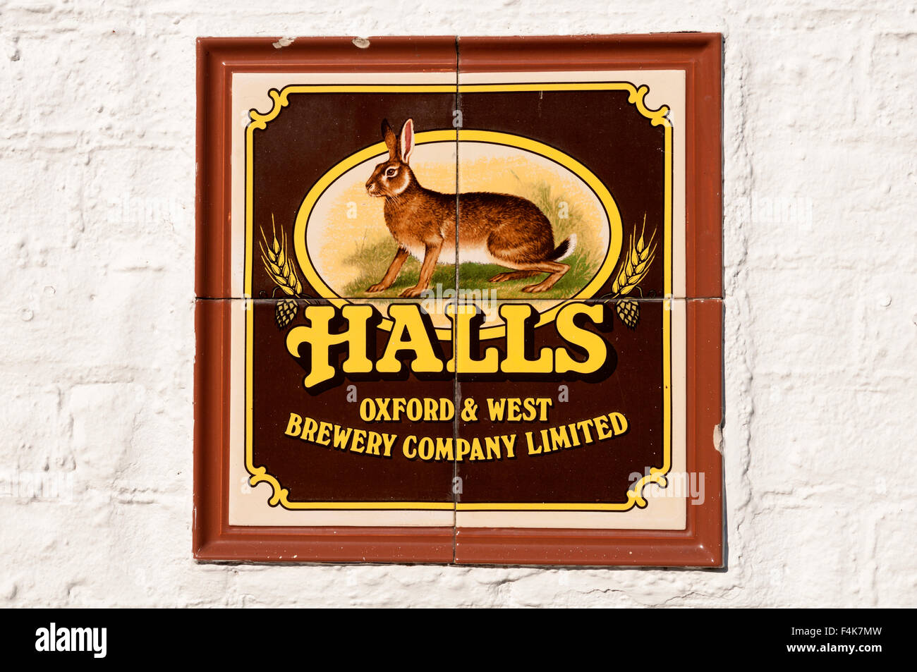 Halls brewery tiles on The Abingdon Arms pub, Beckley, Oxfordshire, England, UK - Stock Image