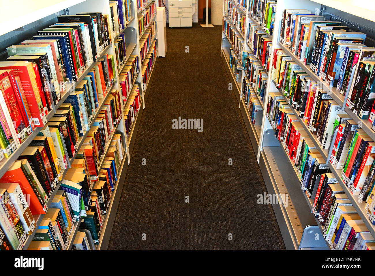 Book shelves in a library - Stock Image