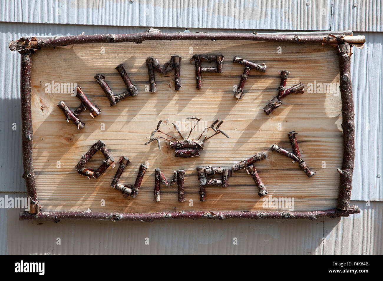 Humpty Dumpty twig sign for cabin that was part of another house. Clitherall Minnesota MN USA - Stock Image