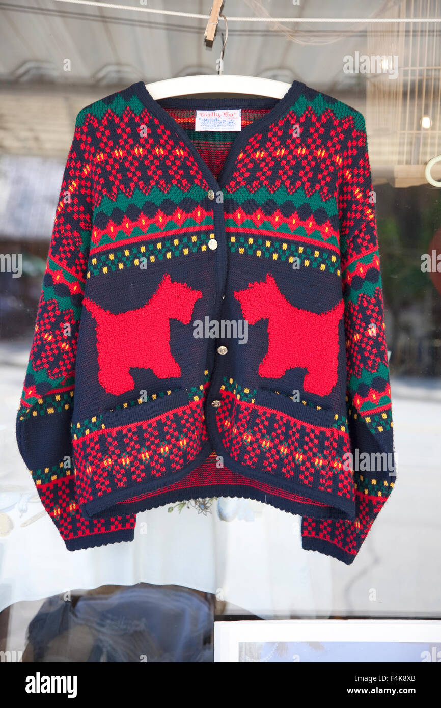 Scotty dog sweater on sale outdoor display at a used clothing boutique. Battle Lake Minnesota MN USA - Stock Image