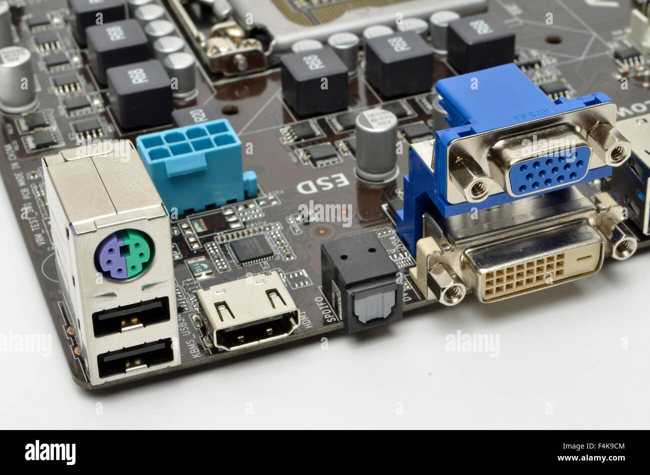 I/O ports on the rear of an ASUS motherboard, including keyboard, USB, HDMI, S/PDIF, VGA, and DVI-D sockets. Stock Photo