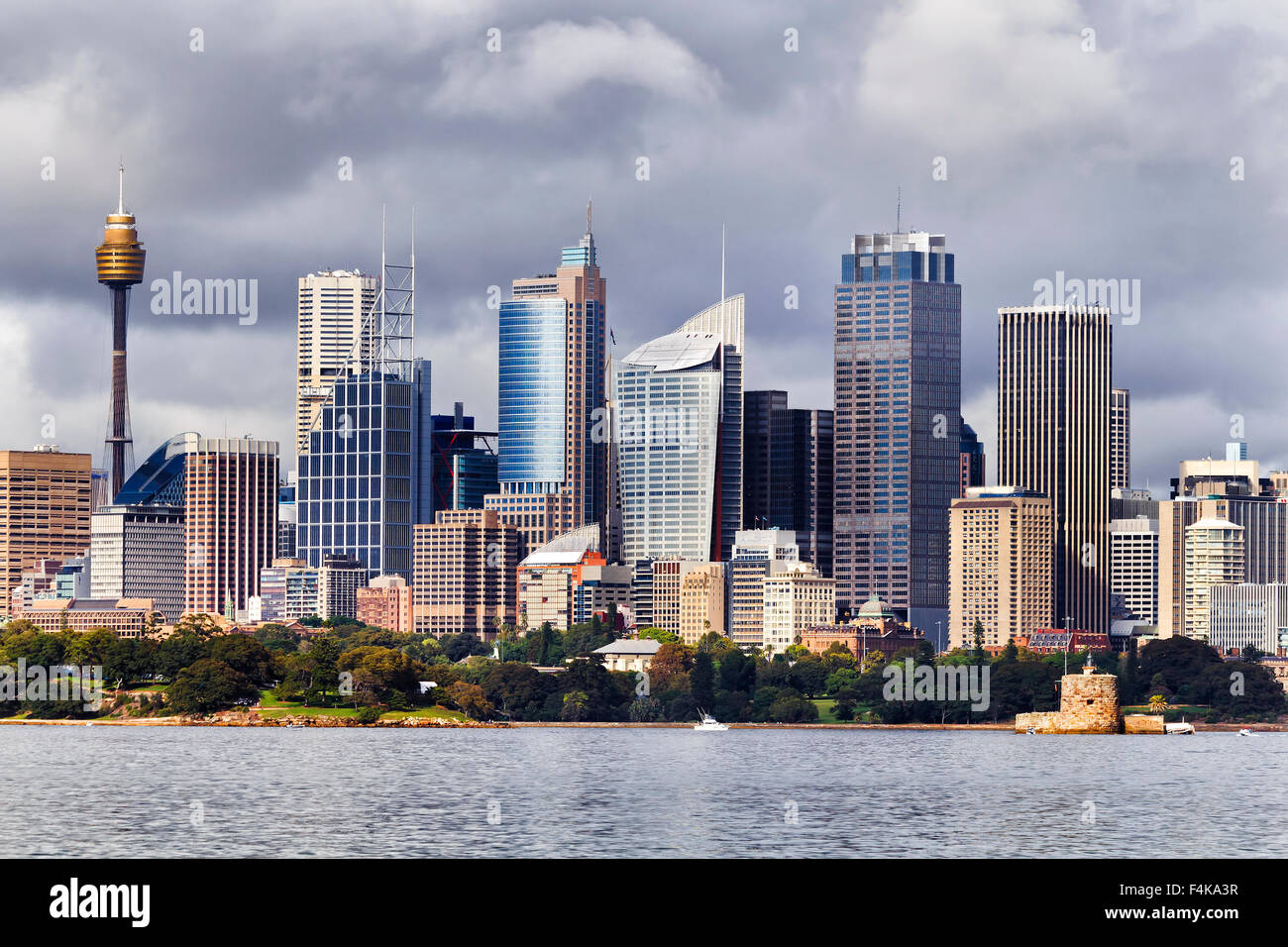 Australian Sydney landmark - city CBD high rises and towers forming megapolis cityscape summer day from harbour - Stock Image