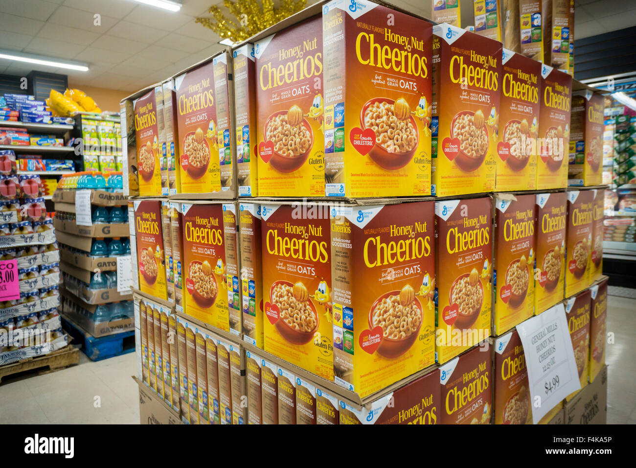 A display of boxes of General Mills Honey Nut Cheerios breakfast cereal in a supermarket in New York on Saturday, - Stock Image