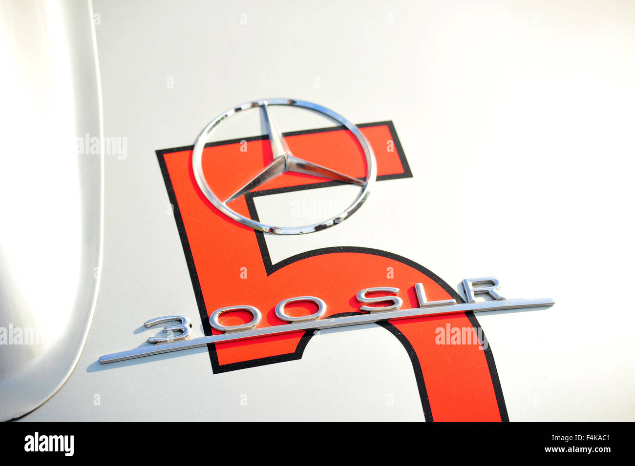 The Mercedes badge on a Mercedes 300 SLR at the Goodwood Festival of Speed in the UK. - Stock Image