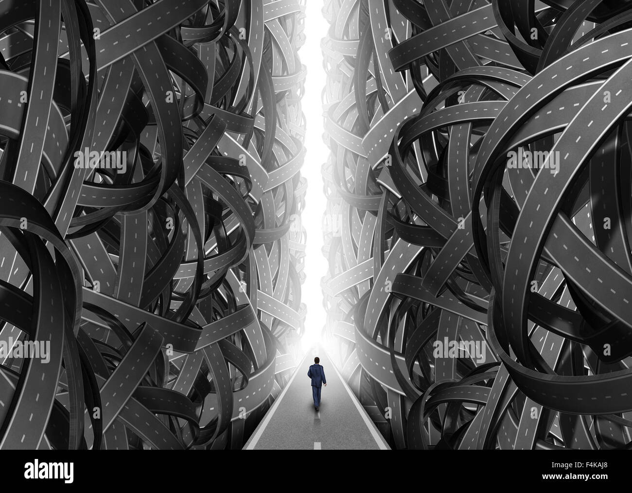 Confusion pathway concept as a businessman walking on a straight  glowing path through an opening of confused roads - Stock Image