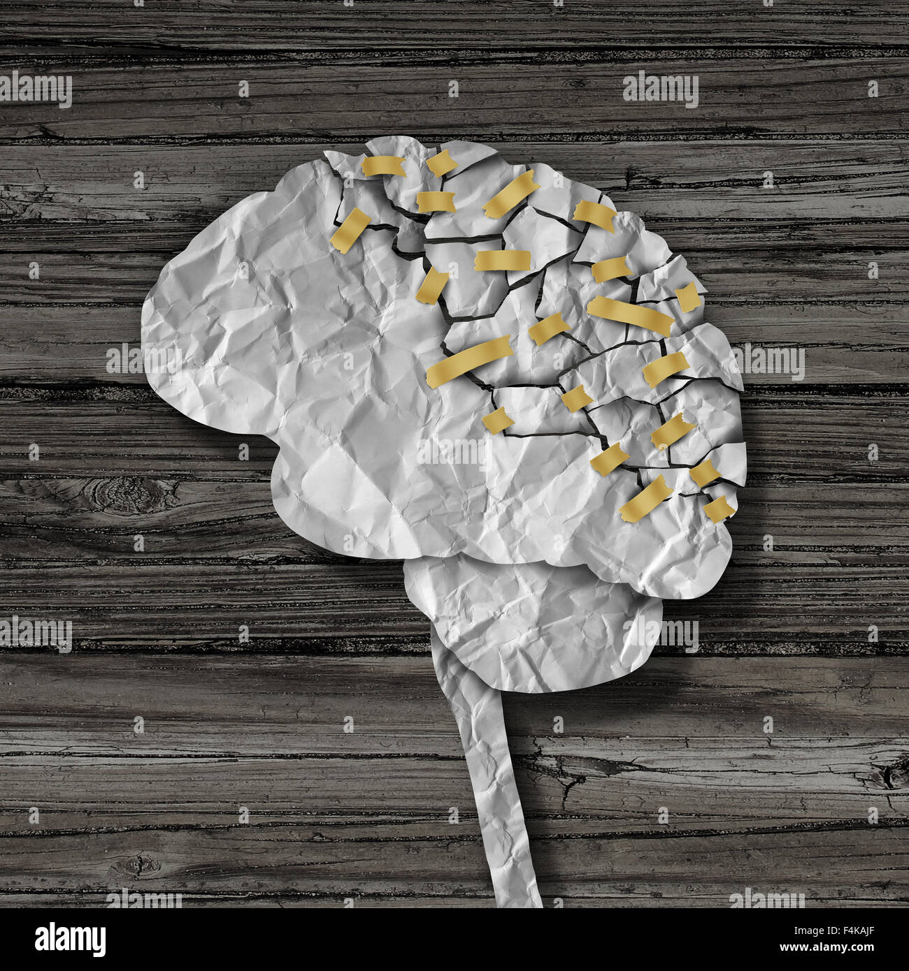 Brain rehabilitation and mental health therapy concept as a crumpled broken paper shaped as the human thinking organ - Stock Image