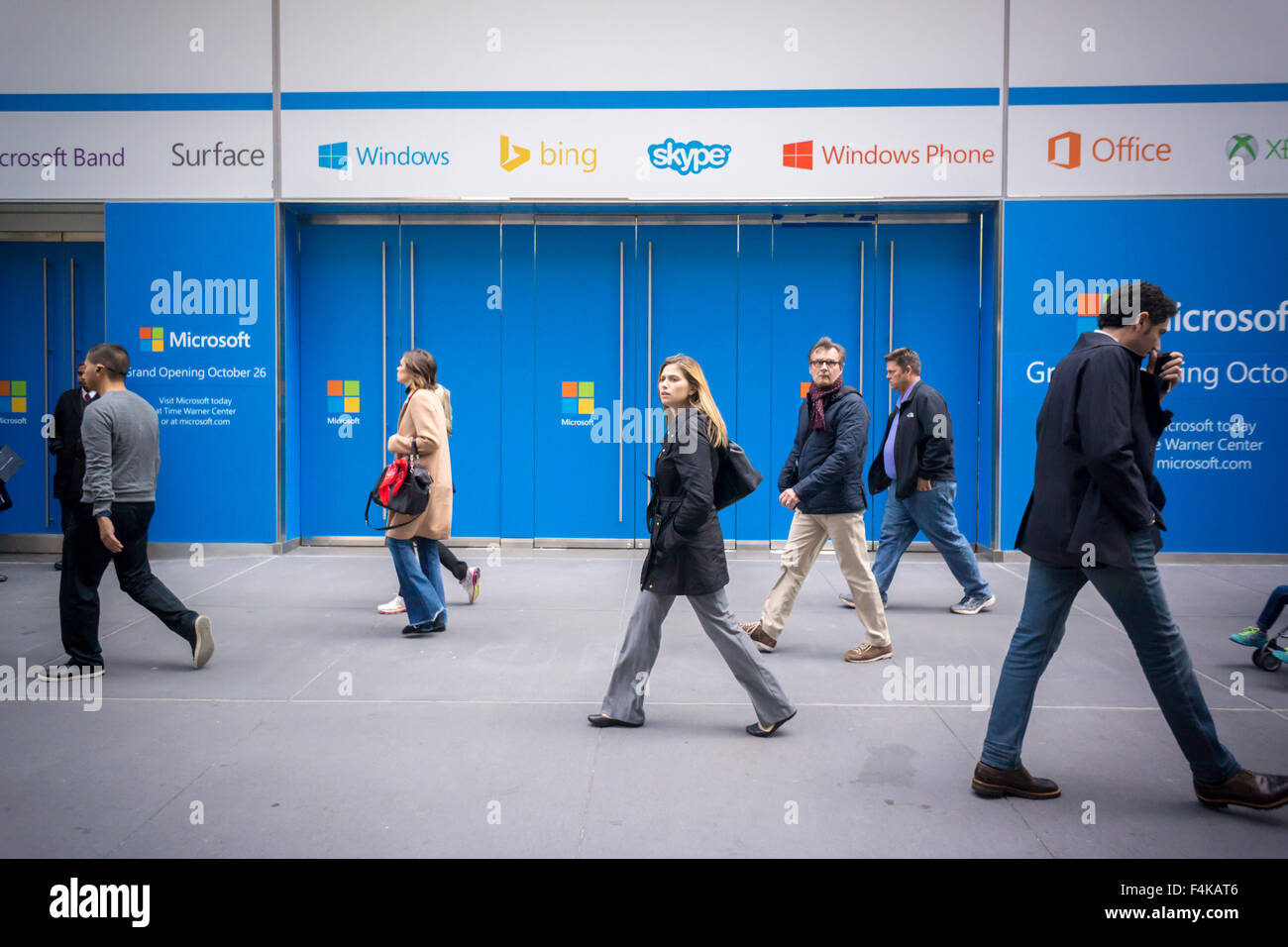 Passer-by walk past the soon to be opened flagship Microsoft store on Fifth Avenue, seen on Friday, October 16, Stock Photo
