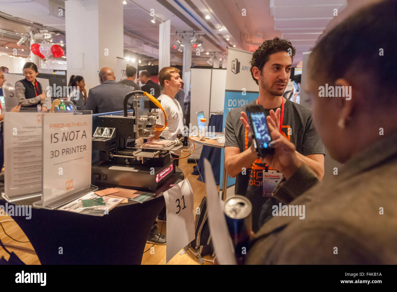 Zippy Robotics founder explains his Prometheus circuit board carving machine at the Techweek expo in New York event Stock Photo