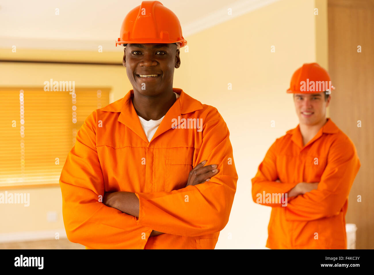 portrait of African workman and co-worker on background - Stock Image