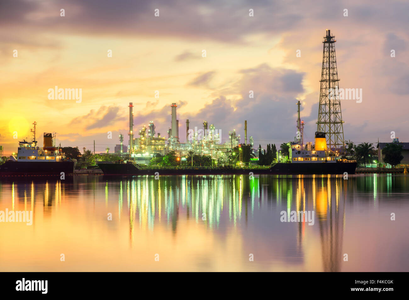 Oil tank ship mooring in oil refinery industry at twilight time - Stock Image