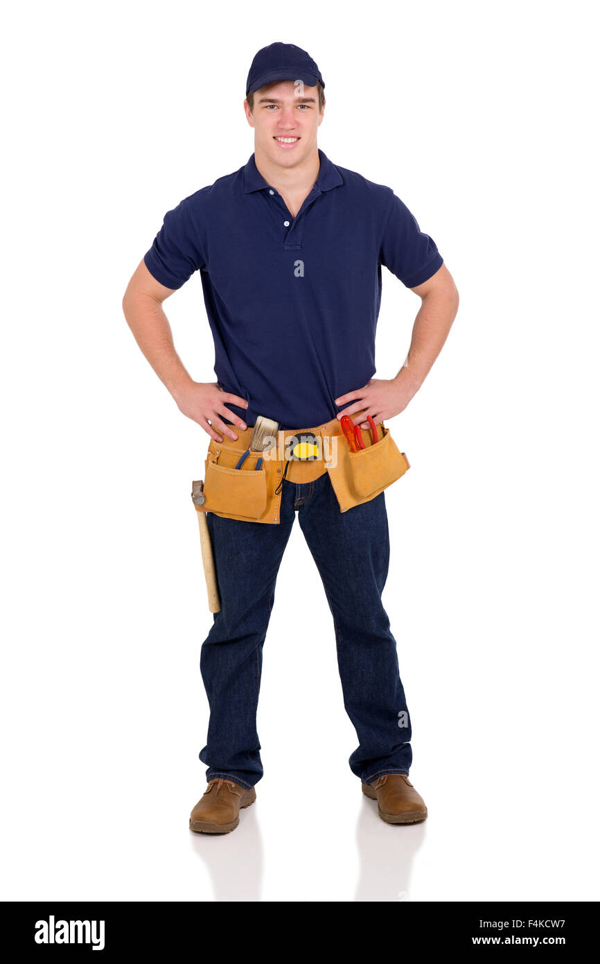 full length portrait of young blue collar worker - Stock Image