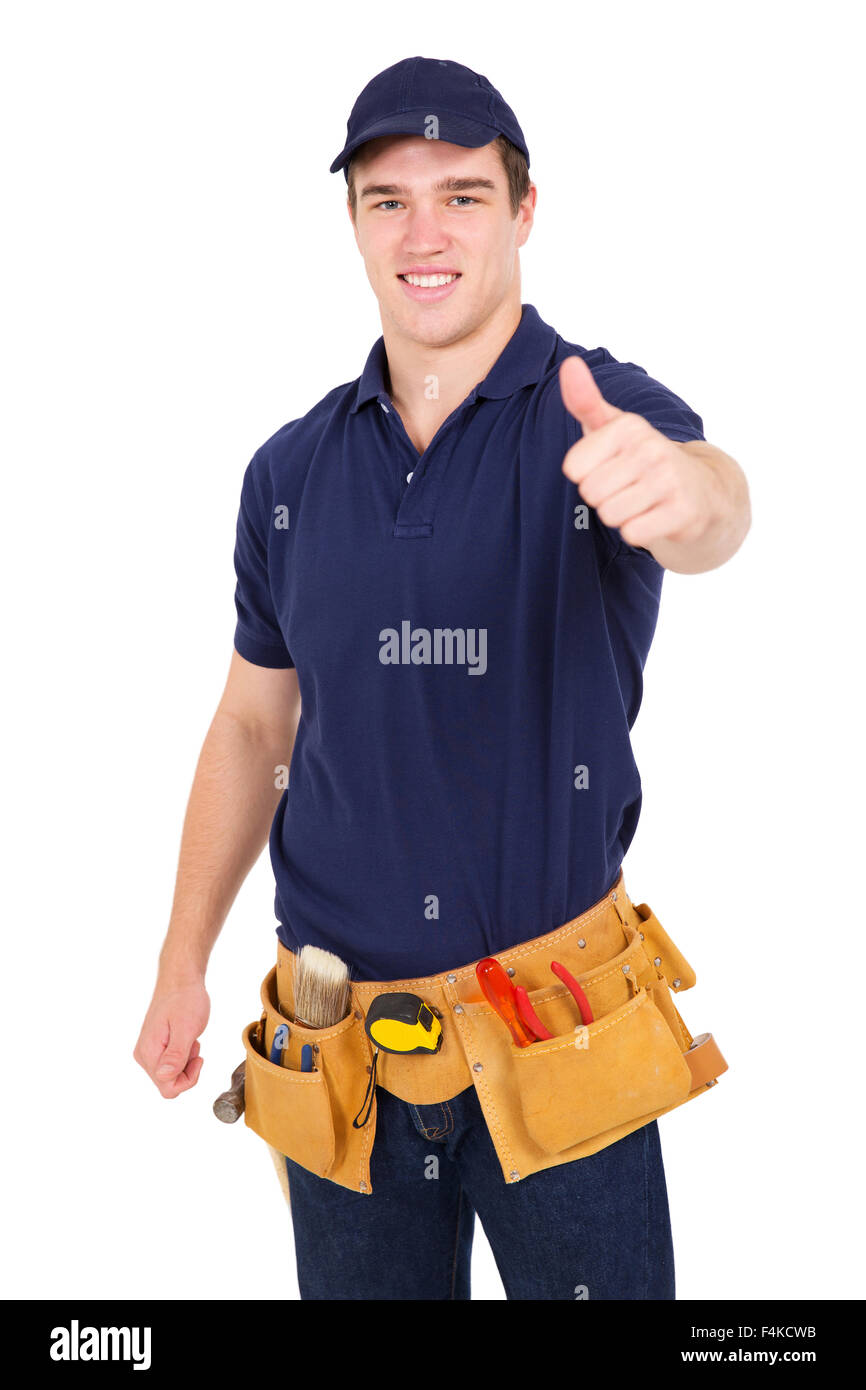 portrait of handsome young handyman giving thumb up - Stock Image