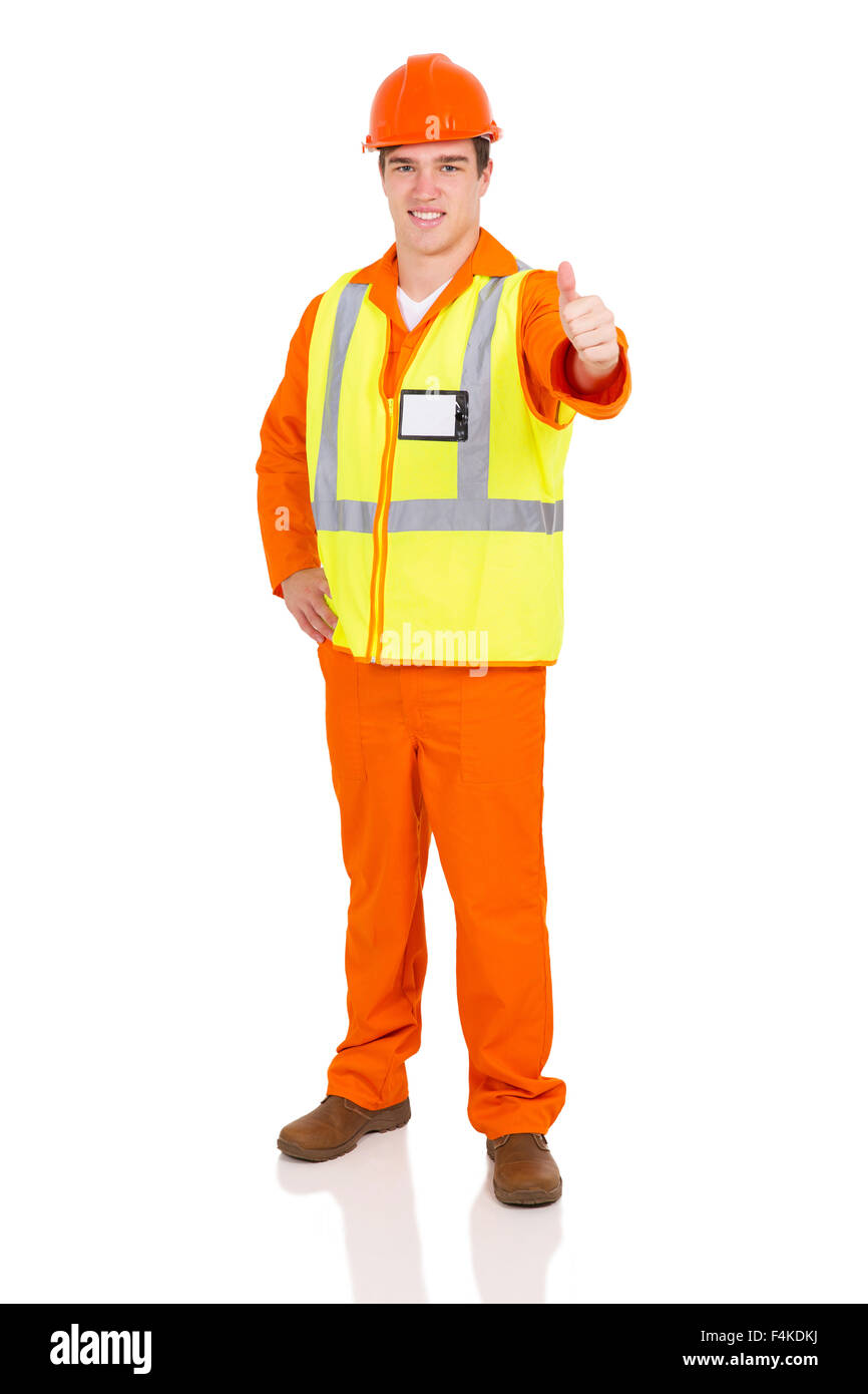 handsome blue collar worker giving thumb up on white background - Stock Image