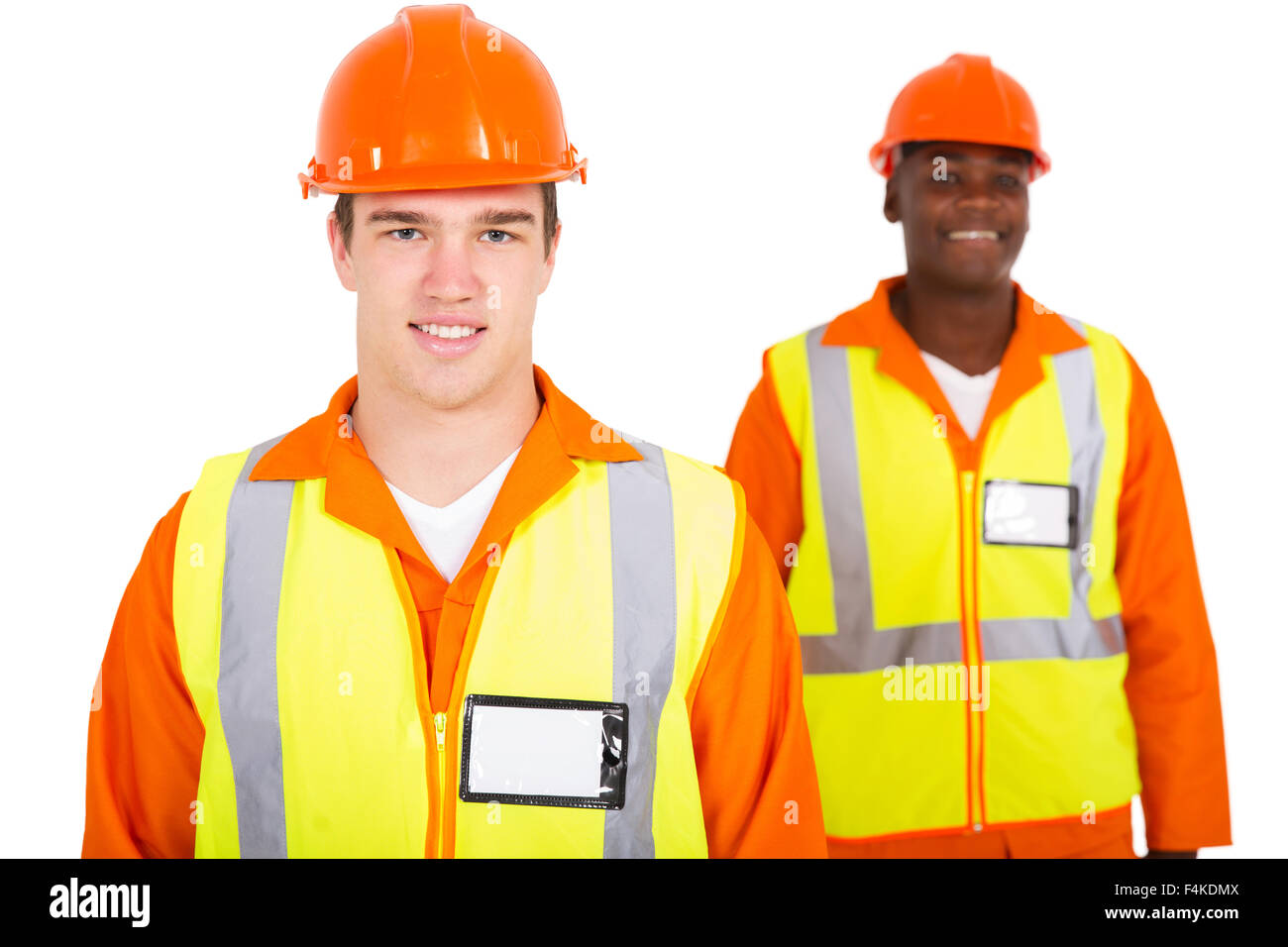 handsome young Caucasian engineer with co-worker - Stock Image