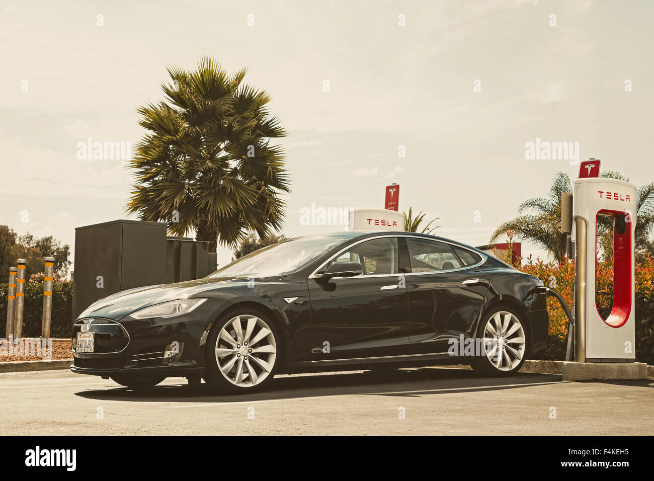 Tesla electric automobile at a charging point Gilroy Califpornia USA - Stock Image