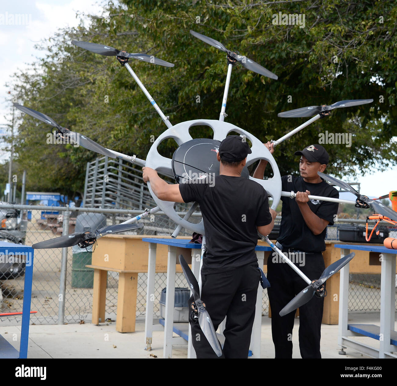 Van Nuys. 19th Oct, 2015. CA/US. Ralph Rebaya of HELIWATCH with their mega drone works on a video shoot Monday.Today - Stock Image