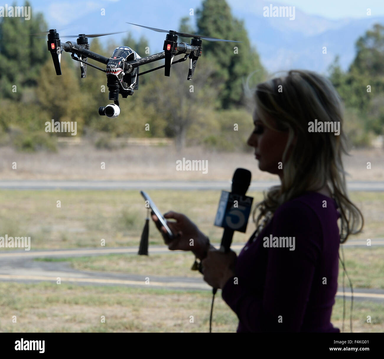 Van Nuys. 19th Oct, 2015. CA/US. Local TV news crews shoot and talk with local drone flyers at Woodley Airpark Monday.Today Stock Photo