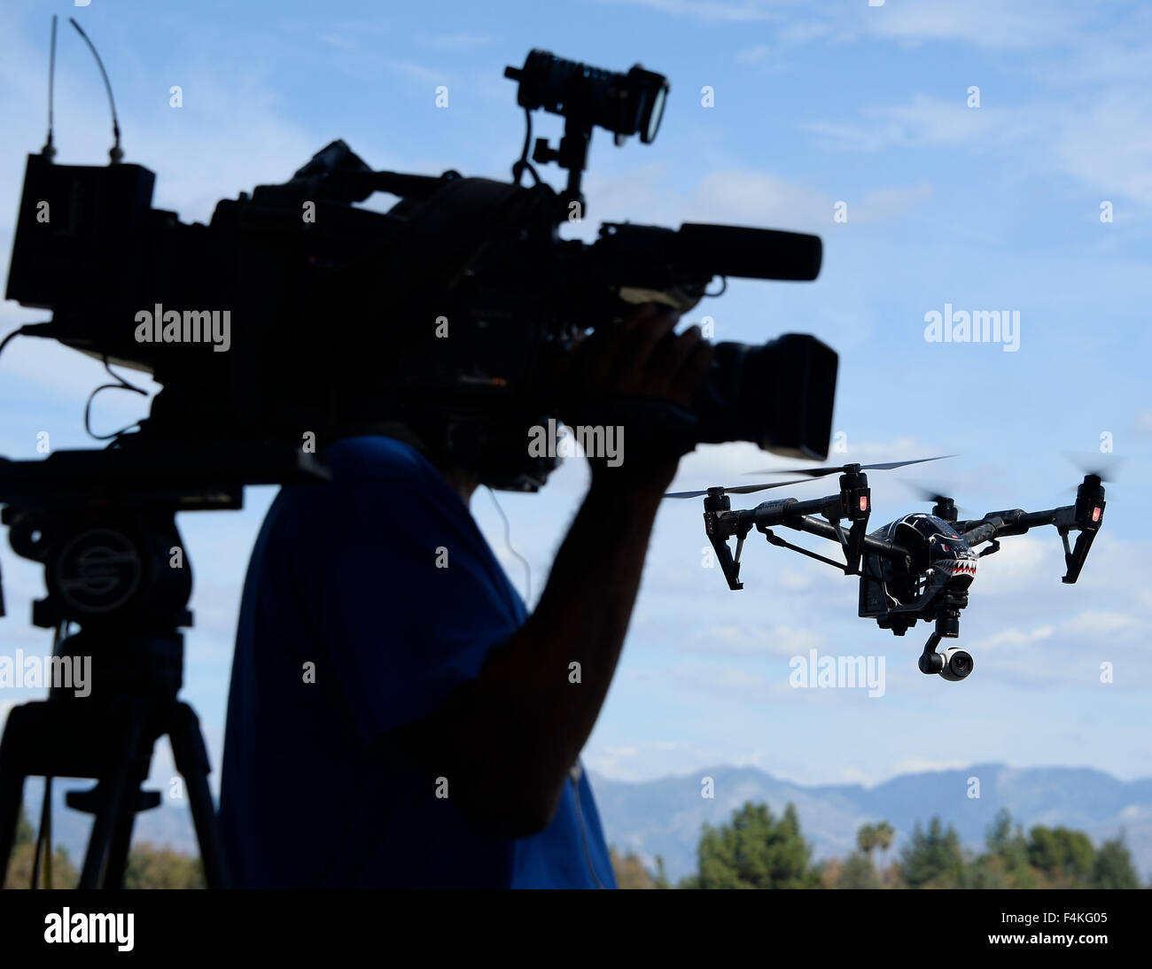 Van Nuys. 19th Oct, 2015. CA/US. Local TV news crews shoot and talk with local drone flyers at Woodley Airpark Monday.Today - Stock Image