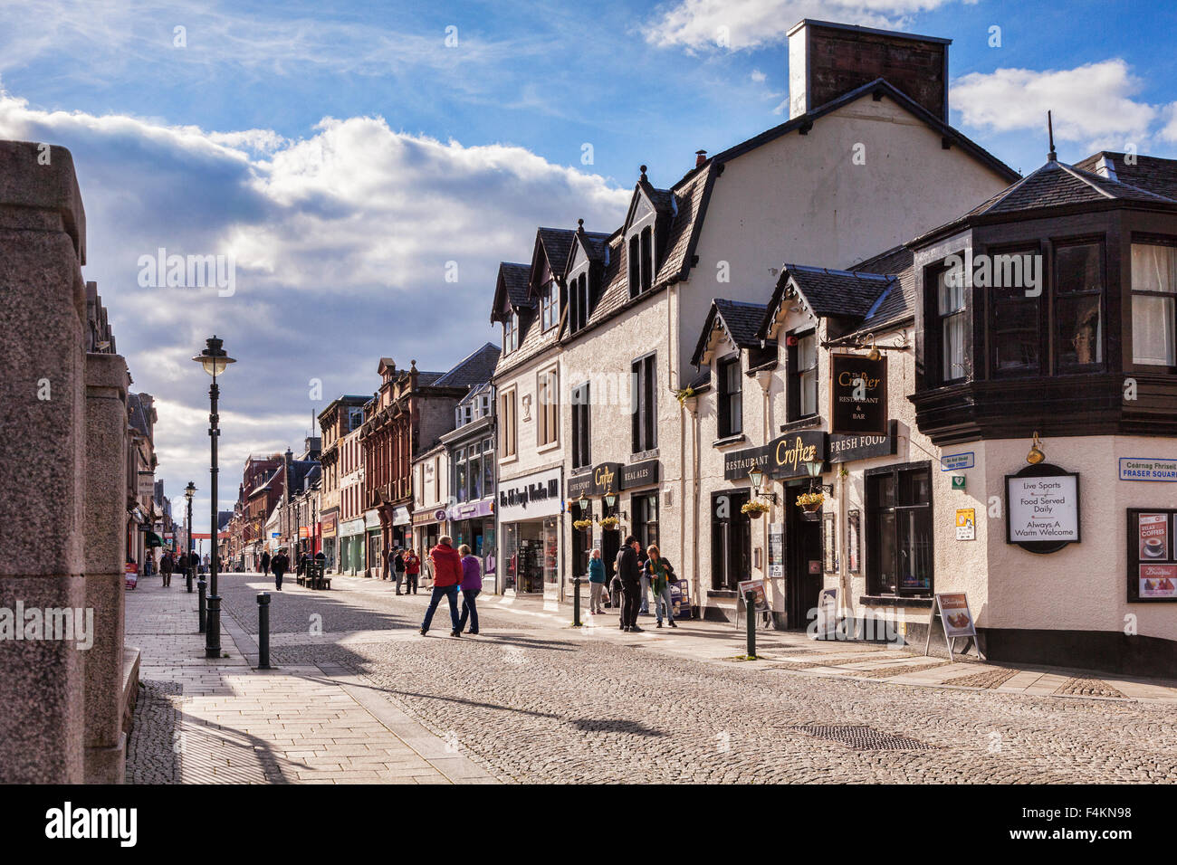 Shoppers and tourists in the High Street, Fort William, Highland, Scotland, UK Stock Photo