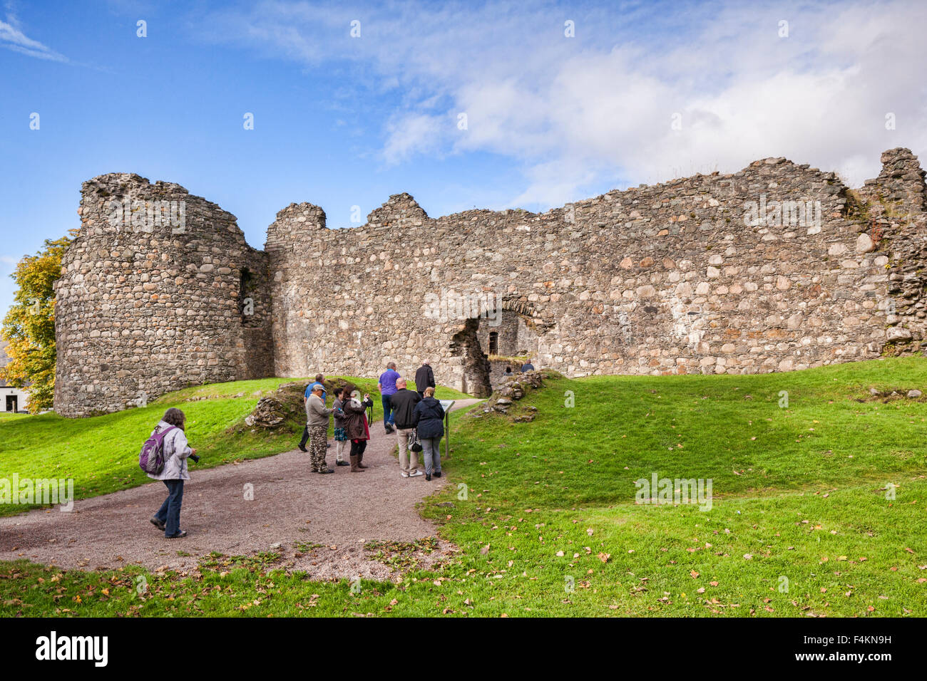 Tourists at Old Inverlochy Castle, Fort William, Highland, Scotland, UK - Stock Image