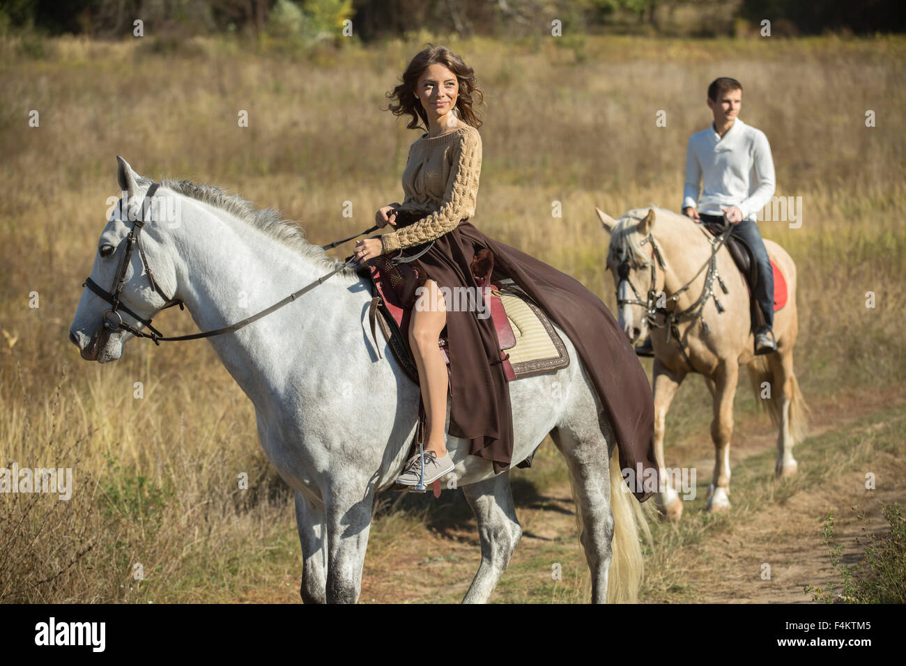 Young couple riding - Stock Image