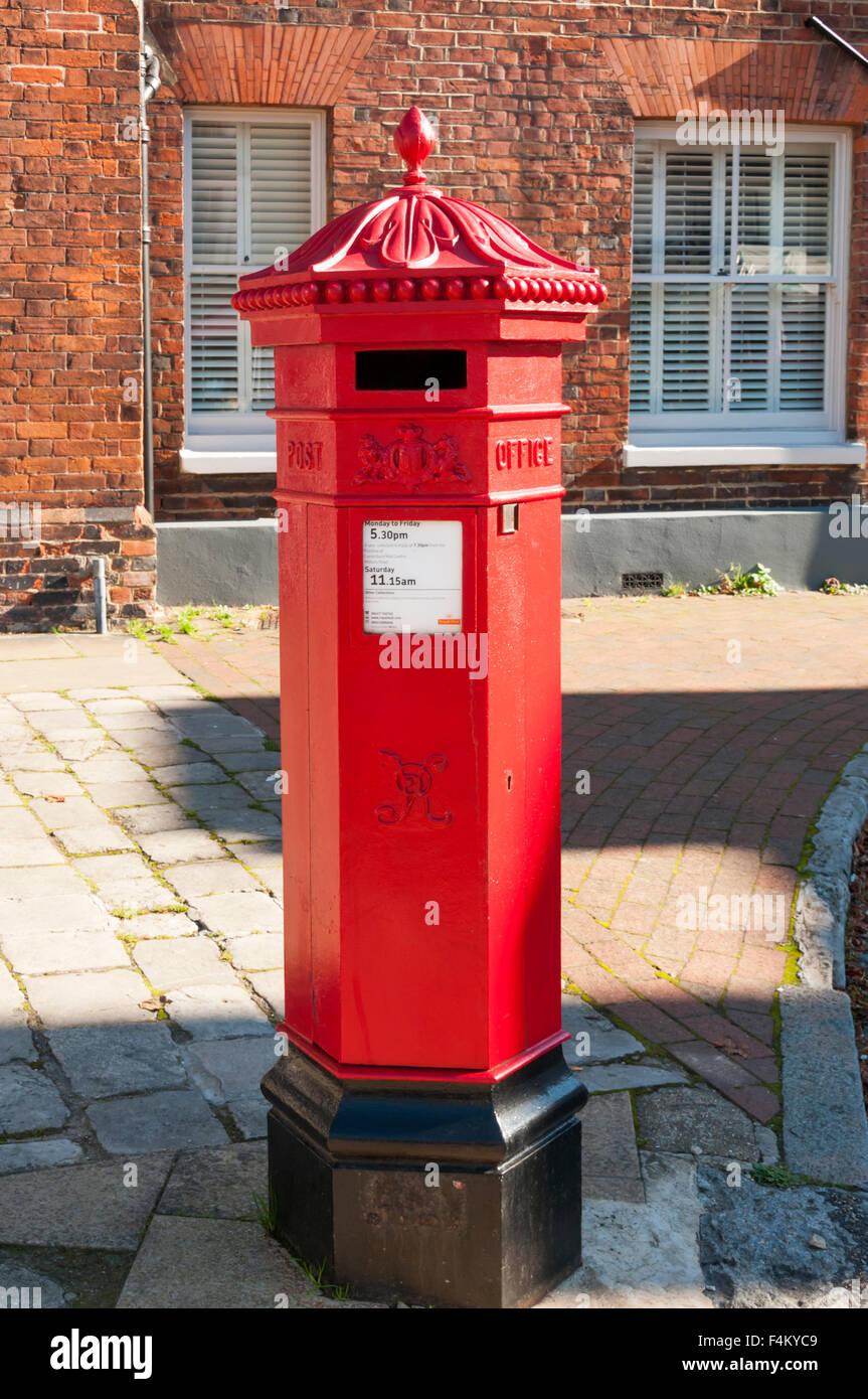 A hexagonal Victorian pillar box in Faversham. - Stock Image