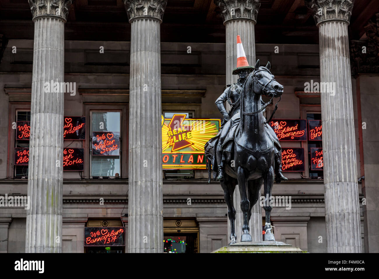 Duke of Wellington Glasgow statue and traffic cone, Gallery of Modern Art, Glasgow city centre, Royal Exchange Square / Queen Street, Scotland, UK Stock Photo