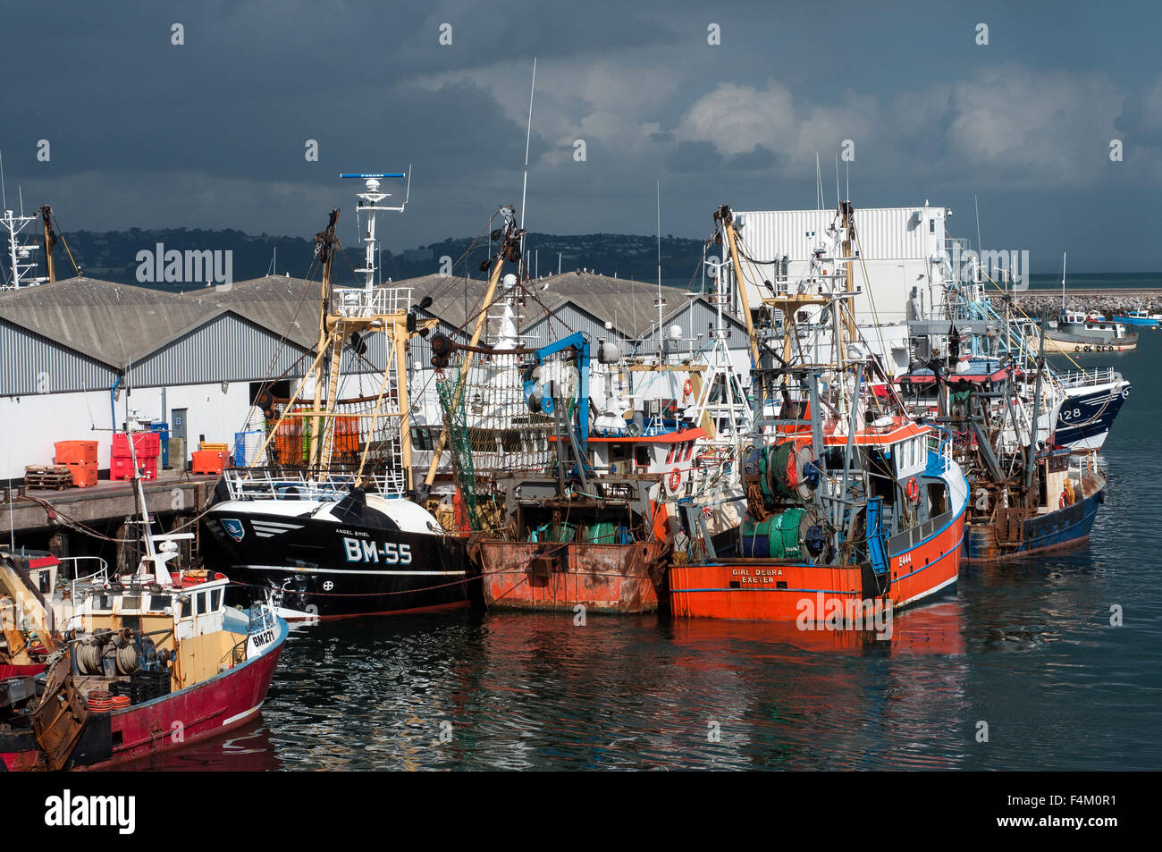 BM 55,boats, brixham, devon, fishing fleet, harbour, industry, quay, trawlers, vessels,trawler, brixham, machinery, - Stock Image