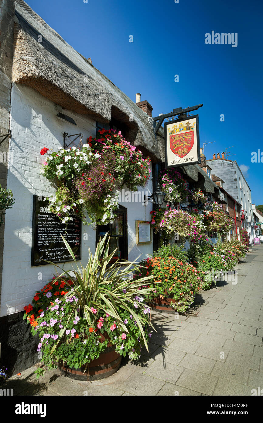 Kings Arms pub, Wareham, Dorset, UK, traditional stone and thatch, bright sun blue sky - Stock Image
