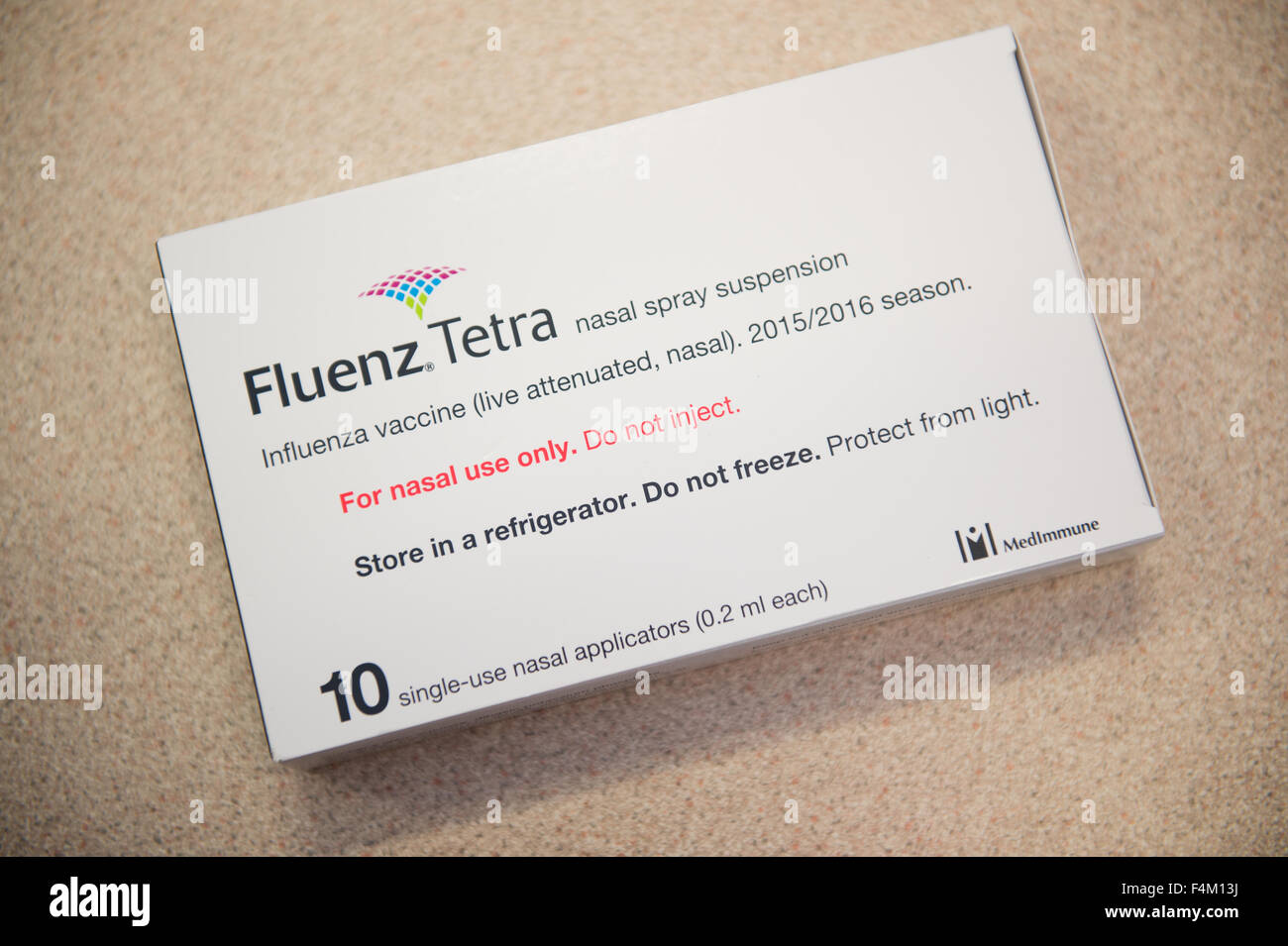 A Packet pack  of 10 doses of Fluenz Tetra influenza flu nasal spray vaccine  for treating children at a primary Stock Photo