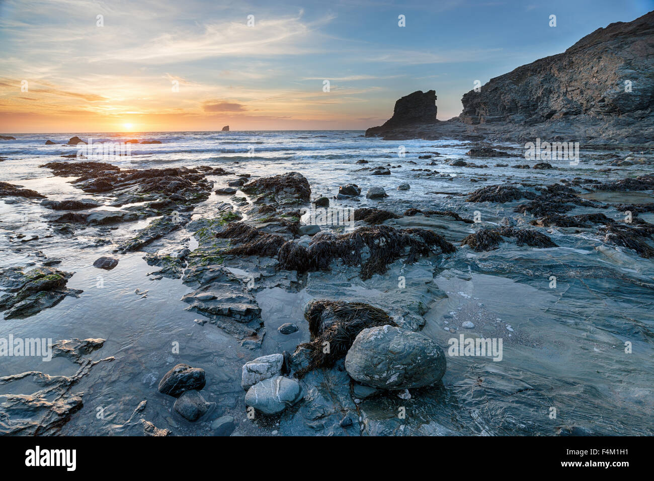 Sunset at Trevellas Coombe, a small rocky cove at St Agnes in Cornwall - Stock Image