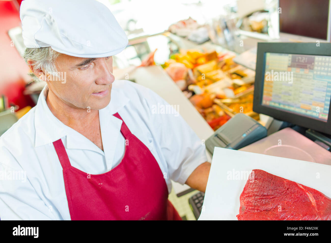 Butcher at work - Stock Image