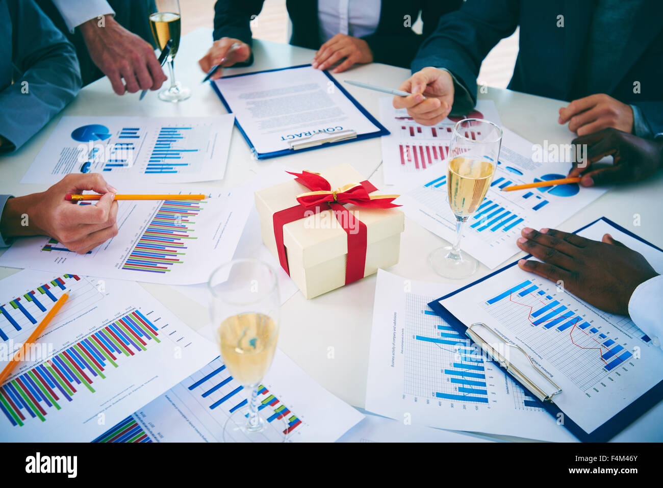 Group of colleagues working on Christmas eve - Stock Image