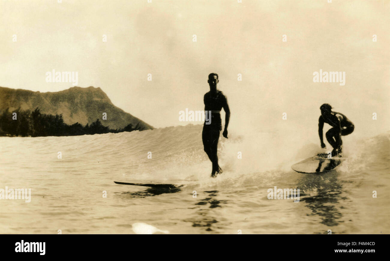 Two surfers take the waves, USA - Stock Image