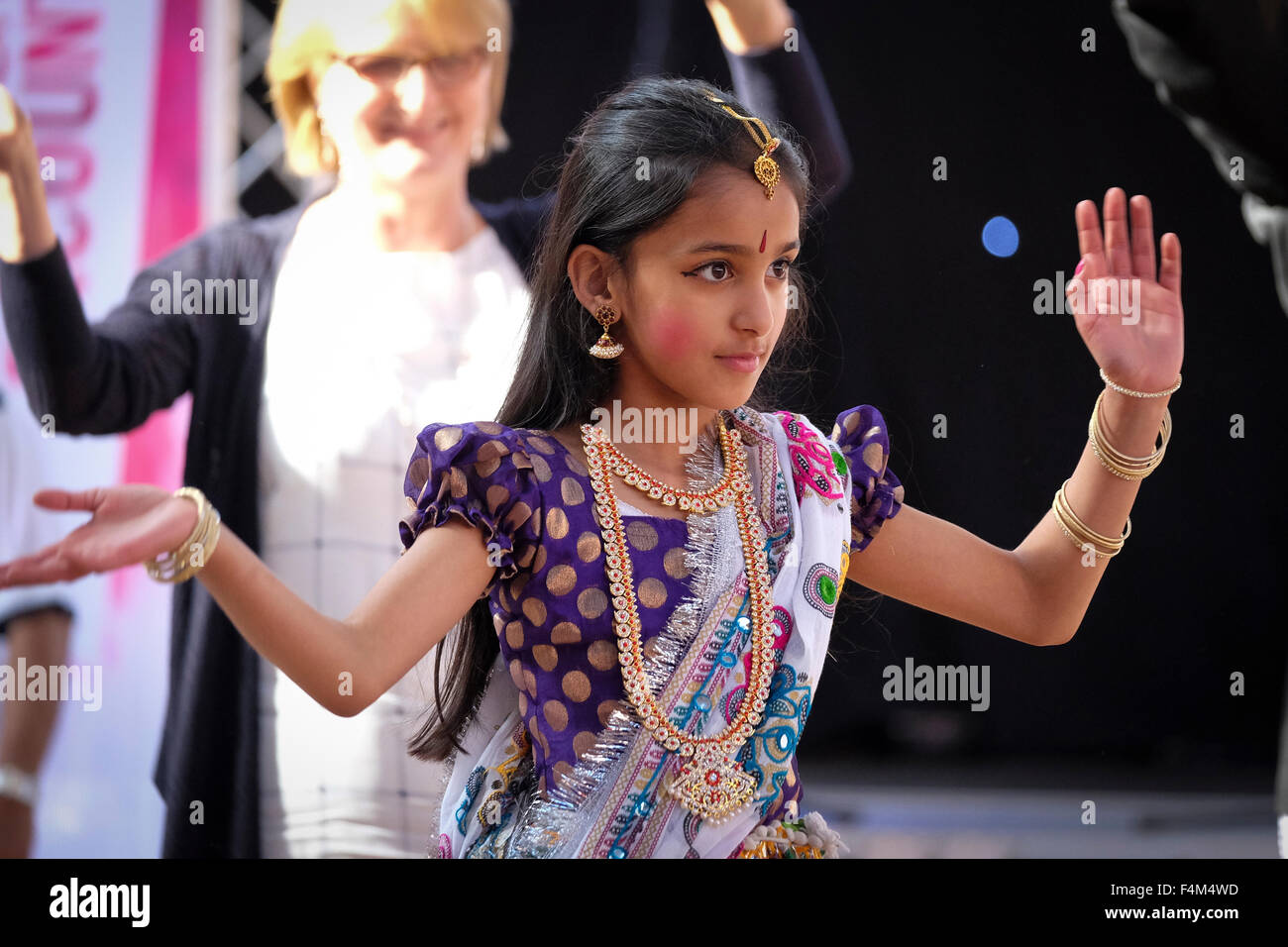 Young Indian girl in traditional Indian costume dancing - Stock Image