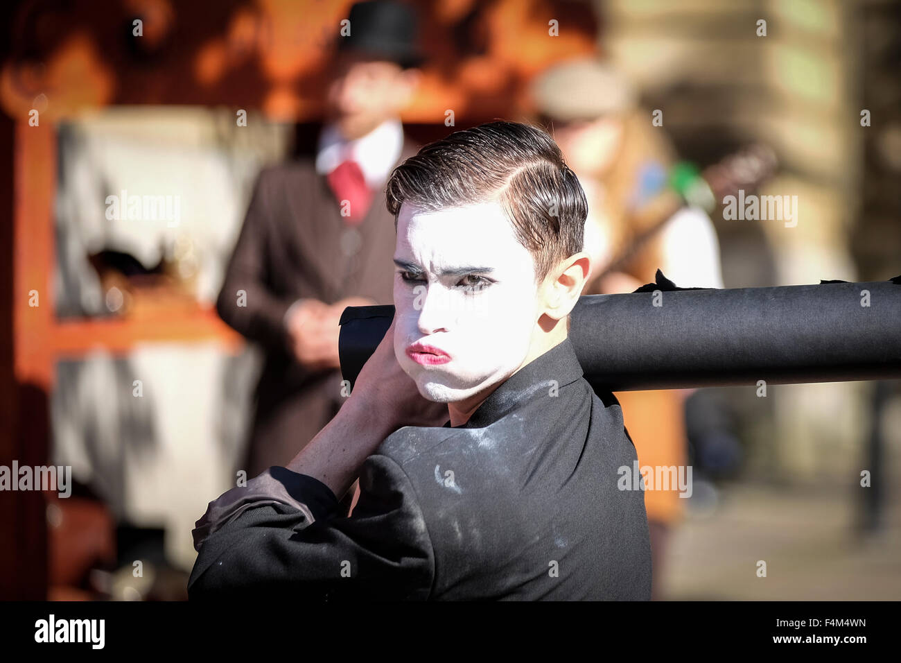 Mime artist puffing out cheeks while 'working' - Stock Image