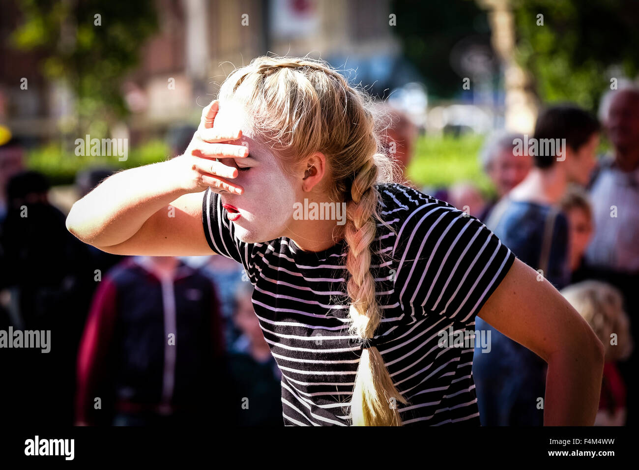 Female mime artist expressing tension Stock Photo