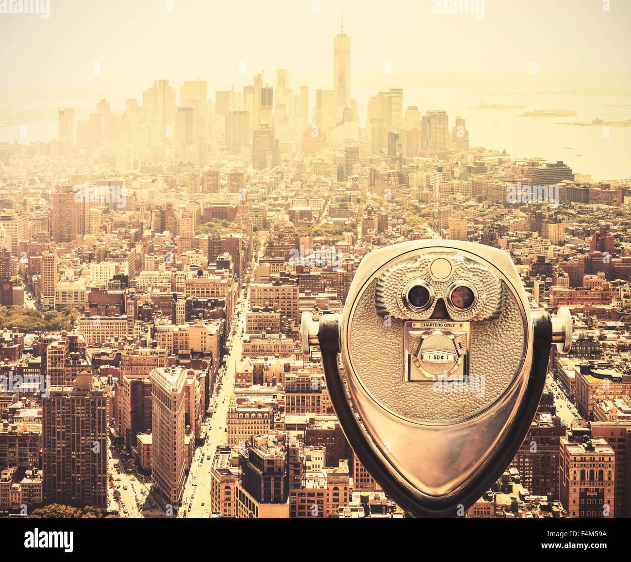 Retro vintage toned tourist binoculars over Manhattan Skyline, New York City, USA. - Stock Image