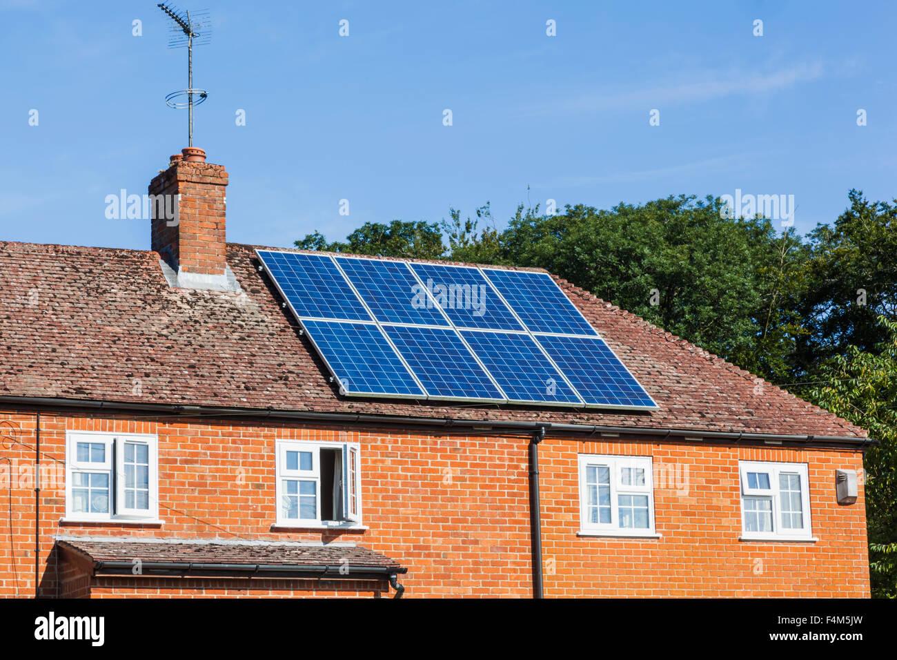 England, Hampshire, Rooftop Solar Panels - Stock Image