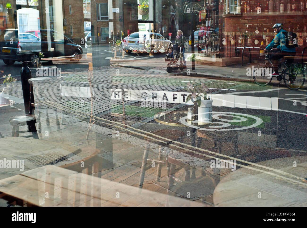 reflection of street scene in window of The Grafton Pub Kentish Town London UK - Stock Image